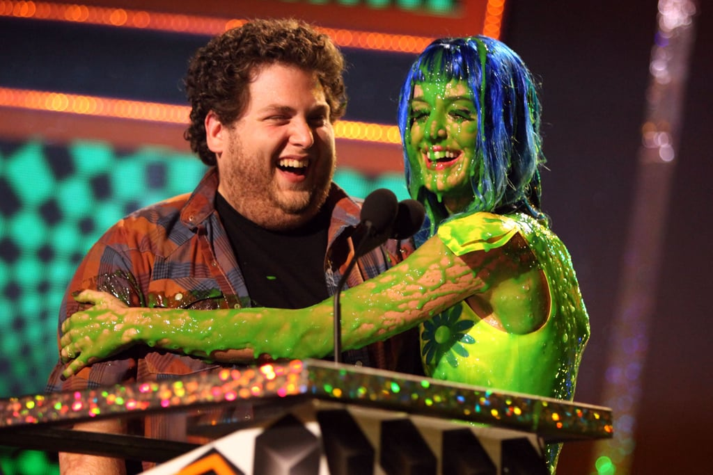 Katy Perry hugged Jonah Hill after getting slimed in 2010.
