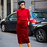 Accent your varying shades of red with dark accessories on the top and bottom.