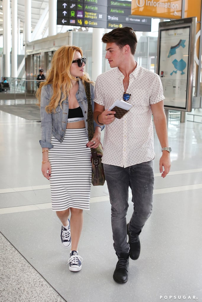 Their relationship is brand-new, but Bella Thorne and Faking It actor Gregg Sulkin are totally in sync when it comes to fashion. The couple was photographed at the Toronto International Airport, checking in together but taking different flights. Bella wore a black and white ensemble made of a high-waisted striped pencil skirt, a Calvin Klein bra top, and her favourite Converse shoes, with the only pop of colour being her blue jean jacket. Gregg opted for a super-cute short-sleeved shirt with distressed dark denim and combat boots. The couple, who walked the red carpet at the 2015 Much Music Awards together, looked so chic and cool, giving us definite #RelationshipStyleGoals. Keep reading for more photos of Bella and Gregg.