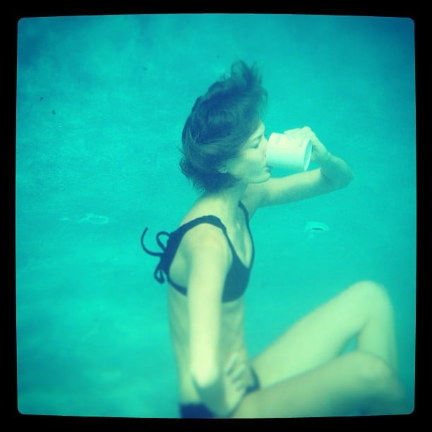 Karlie Kloss drank a cup of coffee while underwater — don't ask us how. Source: Instagram user karliekloss
