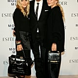 Mary-Kate and Ashley Olsen posed with makeup artist Tom Pecheux.