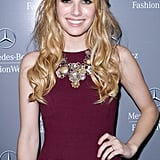 Emma Roberts lends a pop of cool with a collaged bib necklace by Miriam Haskell.