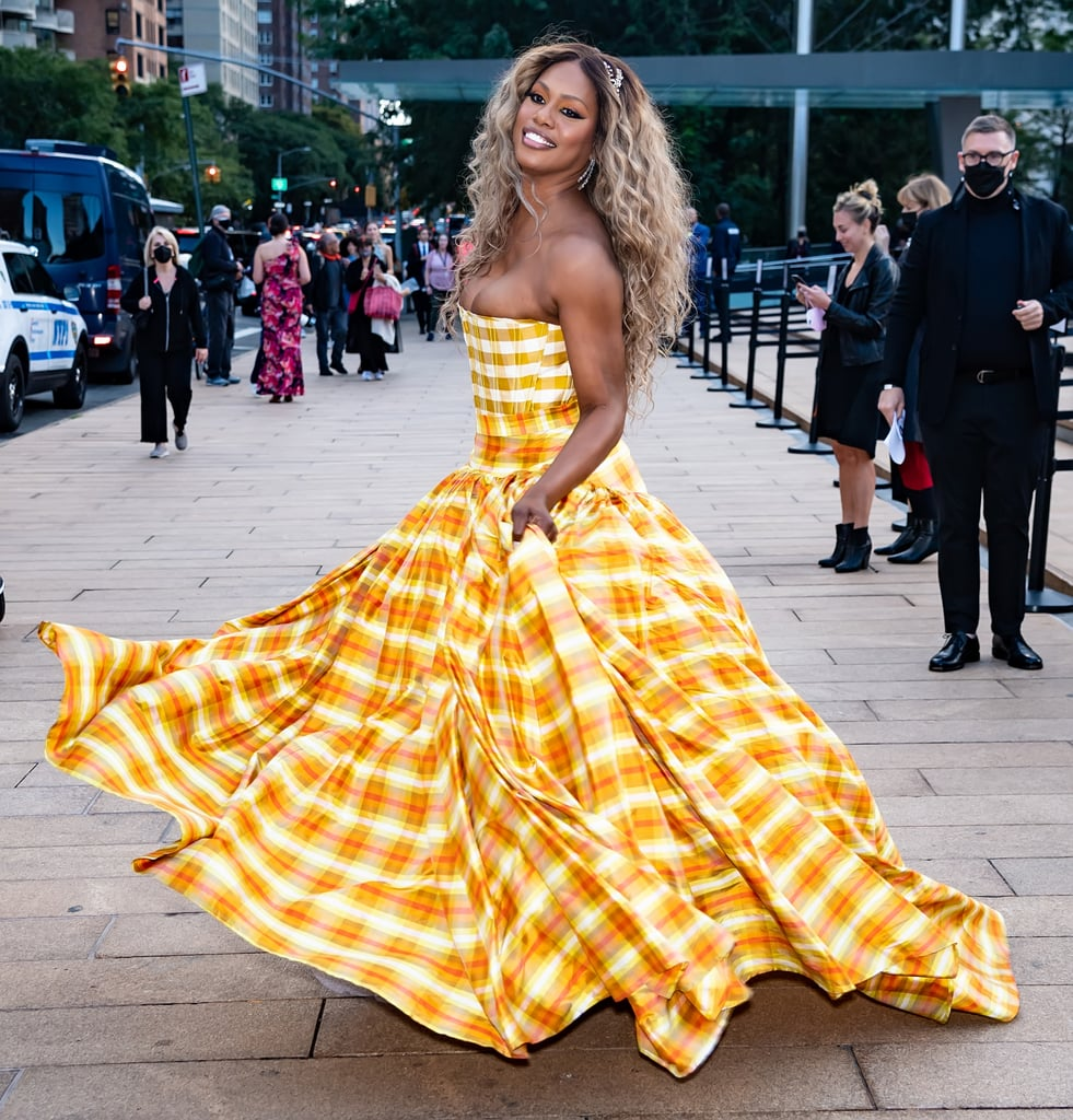 Laverne Cox knows how to turn any street into her very own runway. On 30 Sept., the fabulous Promising Young Woman actress stepped out for the New York City Ballet's Fall Fashion Gala in a stunning Christopher John Rogers gown where she struck many a pose before heading in for the event. Her yellow checkered gown featured a zipped-up corset top and a tulle-filled skirt that screamed it's finally autumn. She paired the outfit with Cicada Jewellery. As one of the cochairs for this year's event, her festive look did not disappoint. Laverne was styled by Christina Joy Pacelli, who is to thank for many of the actress's latest looks — including the silver pleated Johanna Johnson dress she wore to the Academy Museum of Motion Pictures Opening Gala as well as the bright yellow Christina Ottaviano dress for the Metropolitan Opera's reopening night. But the applause-worthy poses and red carpet confidence is all Laverne. Check out photos of Laverne's breathtaking checkered CJR gown at the Fall Fashion Gala, and see how she turned the entrance of the David H. Koch theatre into her very own runway ahead.      Related:                                                                                                           The Hand-on-Hip Pose Never Stood a Chance Against Laverne Cox's Elegant Red Carpet Posing