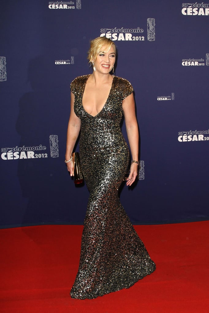 Kate Winslet wore a sequin gown on the red carpet at the César Film Awards in Paris this afternoon. She's receiving an honorary award at the show, which will be presented to her by Carnage director Roman Polanski. The evening's host, Guillaume Canet, also posed for pictures on his way inside, though he was without his partner, Marion Cotillard, since she's currently filming alongside Joaquin Phoenix in NYC. Kate did have her significant other, Ned Rocknroll, along for the trip to France, and the couple were seen arriving at the Ritz earlier today. Kate most recently popped up in NYC for Fashion Week, where she attended multiple events as the face of St. John.