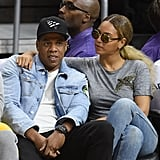 Bey slung her arm around her man as they sat courtside for the Brooklyn Nets and LA Lakers game in February 2016.