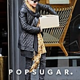 Mary-Kate Olsen left a store with a heavy box while shopping in NYC.