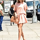 Taylor's peachy pairing felt ultrafeminine thanks to her girlie accessories.