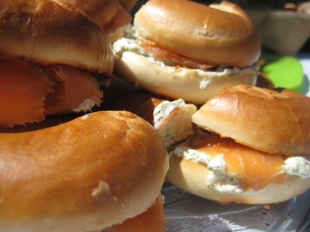 The morning of the brunch toast the bagels and assemble the mini sandwiches. Fill the bagels to your liking.  For mine, I mixed cream cheese with fresh herbs and slathered it on one side of the bagel. Next I topped it with smoked salmon, red onion slices, capers, and the other bagel half.