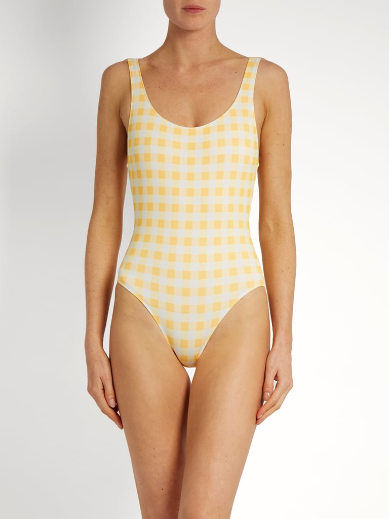 You won't go anywhere without packing the sunshine-yellow Solid & Striped The Anne-Marie Gingham Swimsuit ($158).