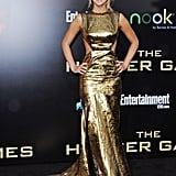 Jennifer Lawrence caught our attention when she stepped out in this  metallic Prabal Gurung gown for the LA premiere of The Hunger Games, and since then, the love for Jennifer has grown and grown.