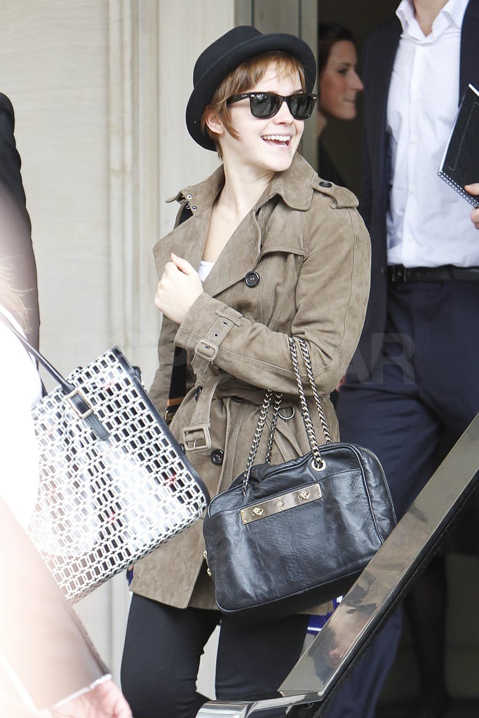 "Emma Watson arrived at Heathrow International Airport earlier today in a dark fedora and suede trench. Yesterday marked the beginning of the end for the Harry Potter actress and her group of costars. The Harry Potter and the Deathly Hallows Part 2 premiere took place in London's Trafalgar Square with close to 20,000 fans coming out to bid farewell to the cast and crew. Emma, who picked a beautiful Oscar de la Renta gown for the occasion, broke into tears thanking her extended Harry Potter family for the wonderful times they shared together on set. Her costar Rupert Grint got a laugh from the crowd when he jokingly celebrated writer J.K. Rowling for everything she's done for the ""ginger people."" Pals Emma, Rupert, and Daniel Radcliffe partied together late into the night at the postpremiere soiree, enjoying their final curtain call as Hermione, Ron, and Harry at home in the UK. The stars are bound for the States this weekend with the US press junket scheduled for Sunday, and join us on Monday when we stream LIVE from the NYC Deathly Hallows 2 premiere!"