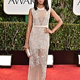 At the 2013 Golden Globe Awards, Kerry was subtle, albeit dazzling, in a sheer nude embellished Miu Miu dress. Nude pumps and a satin clutch played off her look flawlessly.