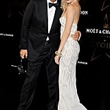 Sienna Miller and Mario Testino at a gala in London.
