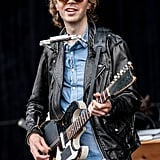 Beck played guitar and the harmonica on stage.