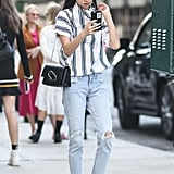 Style the Leather Paper Clip Flap Clutch With Light-Wash Jeans and a Striped Top