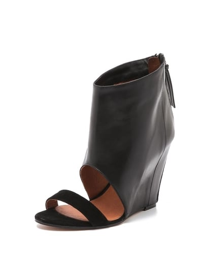 Like a great leather jacket, these Iro Manel wedge sandal boots ($495) will edge up just about any look in your closet, while the wedged heel ensures you can wear them late into your girls' night out.