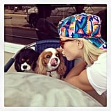 Julianne Hough planted a smooch on her two dogs. Source: Instagram user juleshough