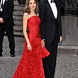 A Strapless Red Cross-Body and Floral Gown