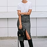 Tuck your white tee into a knee-length skirt to strike that balance between sexy and ease.
