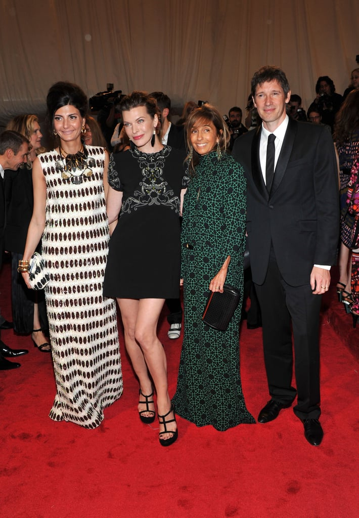 Giovanna Battaglia, Milla Jovovich, and Consuelo Castiglioni, all in Marni, and Paul Anderson