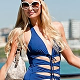 Paris Hilton wore a blue bathing suit with ties in the front to Bondi Beach in Australia.