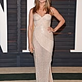 At the 2015 Vanity Fair Oscars Party, Jennifer wore a beige Versace beaded gown.