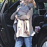 Jennifer gave Seraphina a lift out of the car.