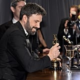 Ben Affleck smiled at his Oscar at the Governors Ball.
