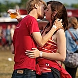 These young lovers managed to balance the beer and kiss at the same time at Roskilde Festival in Denmark. Well done.
