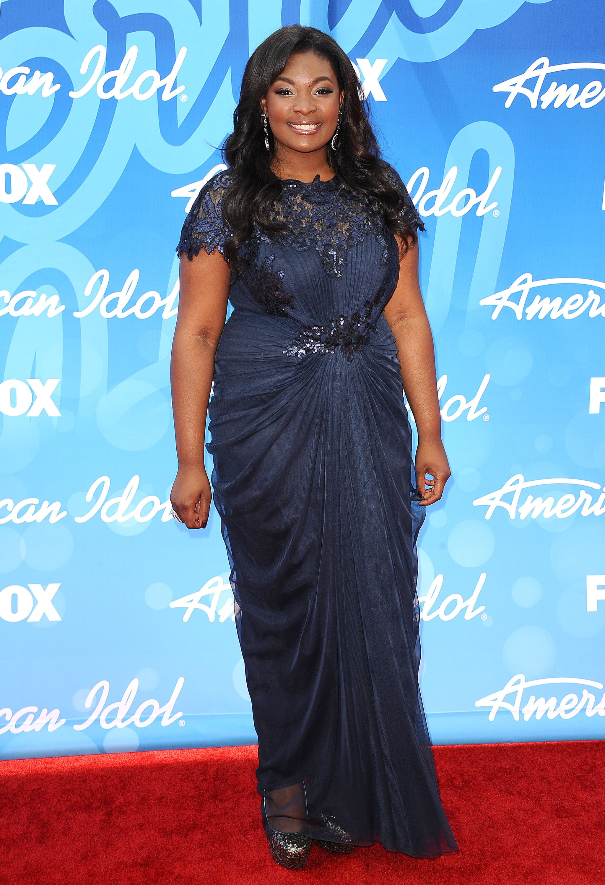 Candice Glover wore a navy blue gown.