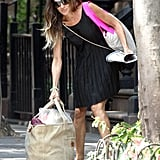 Sarah Jessica Parker carried a bag from her apartment building in NYC.