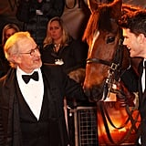 Director Steven Spielberg and actor Jeremy Irvine could barely contain their laughter as they posed with Joey.