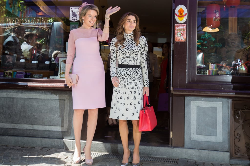 Queen Rania Visited a Chocolate Shop With Queen Mathilde Wearing a Patterned Dress