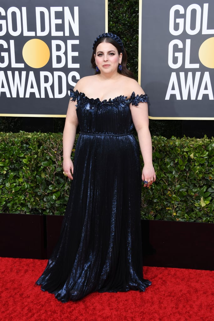 "We first noticed Beanie Feldstein's style when she showed up on the 2018 SAG Awards wearing a black Kay Unger gown, which she actually wore to her high school prom! Feldstein told The Cut that she intended to wear the gown after trying it on one day: ""I put it on and it fit, surprisingly maybe better than it did in high school! I looked at myself and I was like, WHAT!? and my mom and her best friend were just laughing so hard, like, 'You have to wear it! There's just no other dress that would be better.'""  Since then, the 26-year-old has been crushing it with her red carpet style moments and has been with celebrity stylist Erin Walsh. Beanie has a penchant for feminine pieces like flirty dresses by Lela Rose and whimsical prints from designers like Mary Katrantzou and Erdem. The Lady Bird and Booksmart actress has worn everything from a regal Oscar de la Renta gown and matching headband, which she wore to the 2020 Golden Globes, to a red and pink Lela Rose gown with Tory Burch earrings at the Critics' Choice Awards. She's even landed her first campaign with Aerie as an #AerieREAL Role Model. Keep reading to see some our favourite style moments from the star ahead."