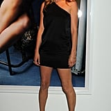 A sexy one-shoulder black minidress with classic stilettos reminded us why Kate has supermodel status when she posed at a private view of Mario Testino's Kate Who? exhibition in 2010.