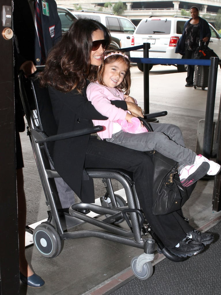 Salma Hayek held Valentina in her lap as they were pushed through LAX in a wheelchair Saturday. Salma and Valentina were all smiles for the airport ride, which was apparently just for fun and not due to any actual injury. The mother-daughter duo have been jet-setting all month long with stops in Venice, NYC, and Toronto, where Salma premiered Americano at the TIFF. Salma had even more to celebrate recently since last Wednesday was Valentina's fourth birthday. The youngster is already following in her mom's footsteps as a mini fashion icon, though both ladies were a little more casual for their recent outing.