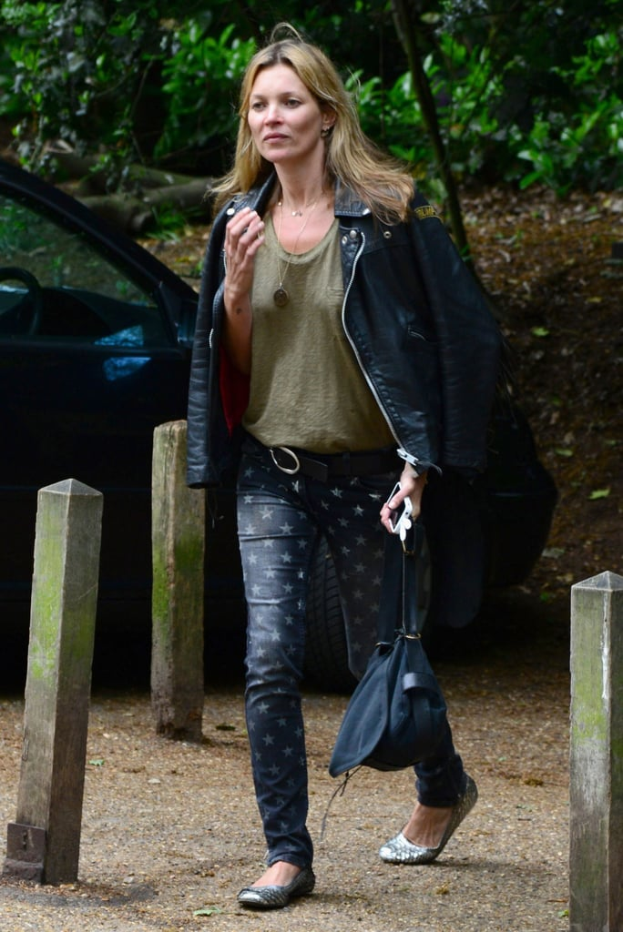Kate Moss got trendy in a pair of star-print denim and a black leather jacket in London.