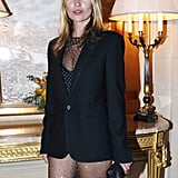 Kate Moss threw a black blazer over her studded bodysuit.