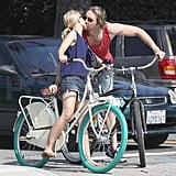 Kristen and Dax stopped their bikes to share a kiss.