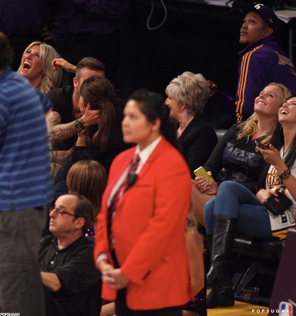 David Beckham and Victoria Beckham kissed at a Lakers game.