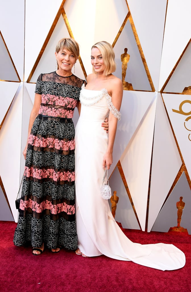 "Margot Robbie turned the 2018 Oscars into a family affair. The I, Tonya star, who's nominated for best actress for her performance in the movie, brought along her gorgeous mom as her date on the red carpet. Fans couldn't help but point out how similar her mother, Sarie Kessler, looks in comparison to another Hollywood actress: Robin Wright! ""Margot Robbie's mom is unsurprisingly gorgeous and looks like Robin Wright. I love it!,"" one user tweeted. ""No one told me Margot Robbie's mom was Robin Wright,"" another person wrote. Keep reading to see more photos of Margot and Robin Wright's twin Sarie on the red carpet."