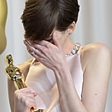 Anne Hathaway was overcome with emotion in the Oscars press room.