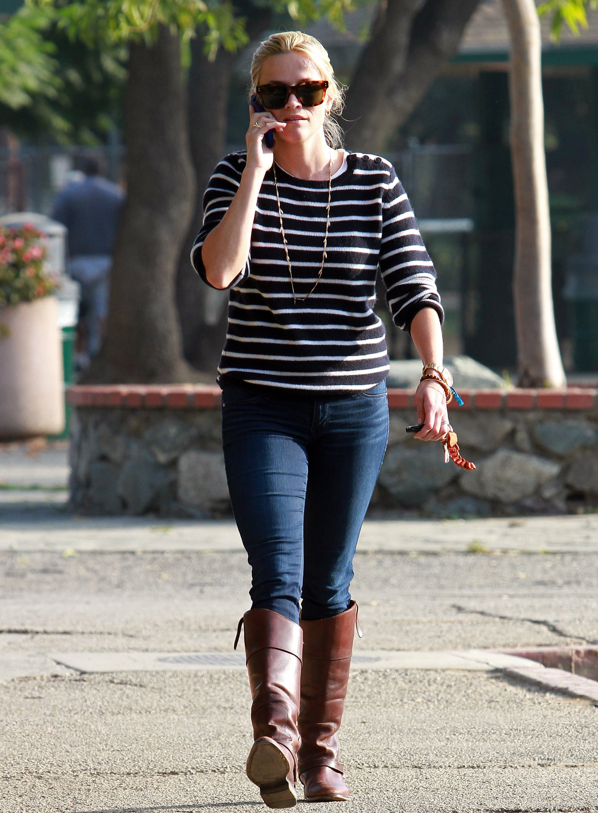 For a day of errands, Reese tucked her skinny jeans into cognac-colored boots and paired them with a chic striped top.
