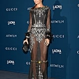 Although Nicole Richie donned a long-sleeved, floor-length dress to the gala, she was in perhaps the night's most revealing look. The sheer, tiered Dolce & Gabbana dress left little to the imagination with expertly placed silver embroidery and feather cuffs at the wrists.