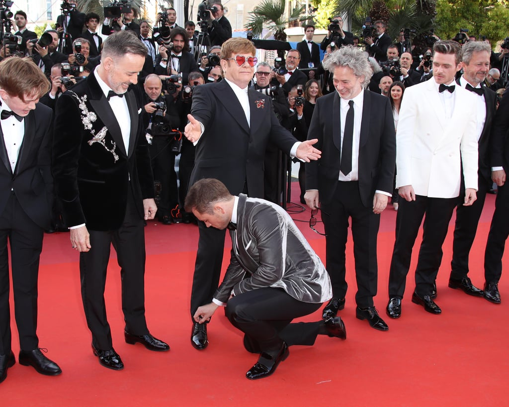 Finally, Taron Adds 1 Last Touch to Elton's Now Properly Tied Shoe