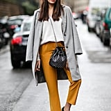 Keep It Casual in White Kicks, Cropped Trousers, and a Structured Coat