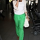 Eva Mendes turned heads in an electric green Alice + Olivia iteration — pairing the breezy pants with a white t-shirt and brown booties.