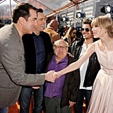Taylor Swift and Rob Riggle shook hands.