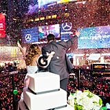This couple celebrated their nuptials with a few million of their nearest and dearest... in the middle of Times Square on New Year's Eve.