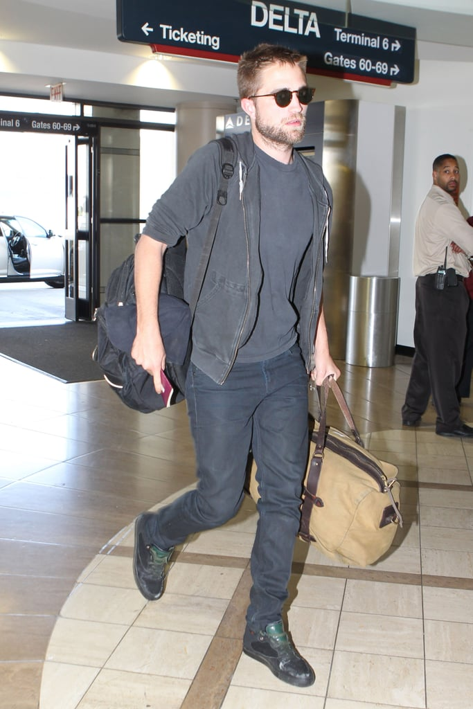 Robert Pattinson had his hands full with two big bags when he was spotted departing LAX yesterday. The actor is still sporting a shaved head from when he filmed The Rover in Australia for a few months earlier this year. He was quick to reunite with girlfriend Kristen Stewart when he returned to the US, and they were one of the many celebrity couples enjoying the first weekend of Coachella last week. In his professional life, Robert has also added another film to his slate, with reports he'll be reuniting with his Cosmopolis director, David Cronenberg, to star in the thriller Maps to the Stars with Julianne Moore and John Cusack.